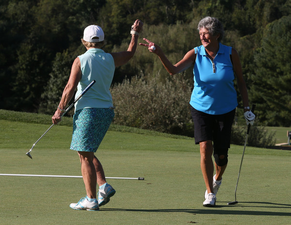 Photo of two golfers playing in a tournament in memory of two woman who fought for ovarian cancer awareness.