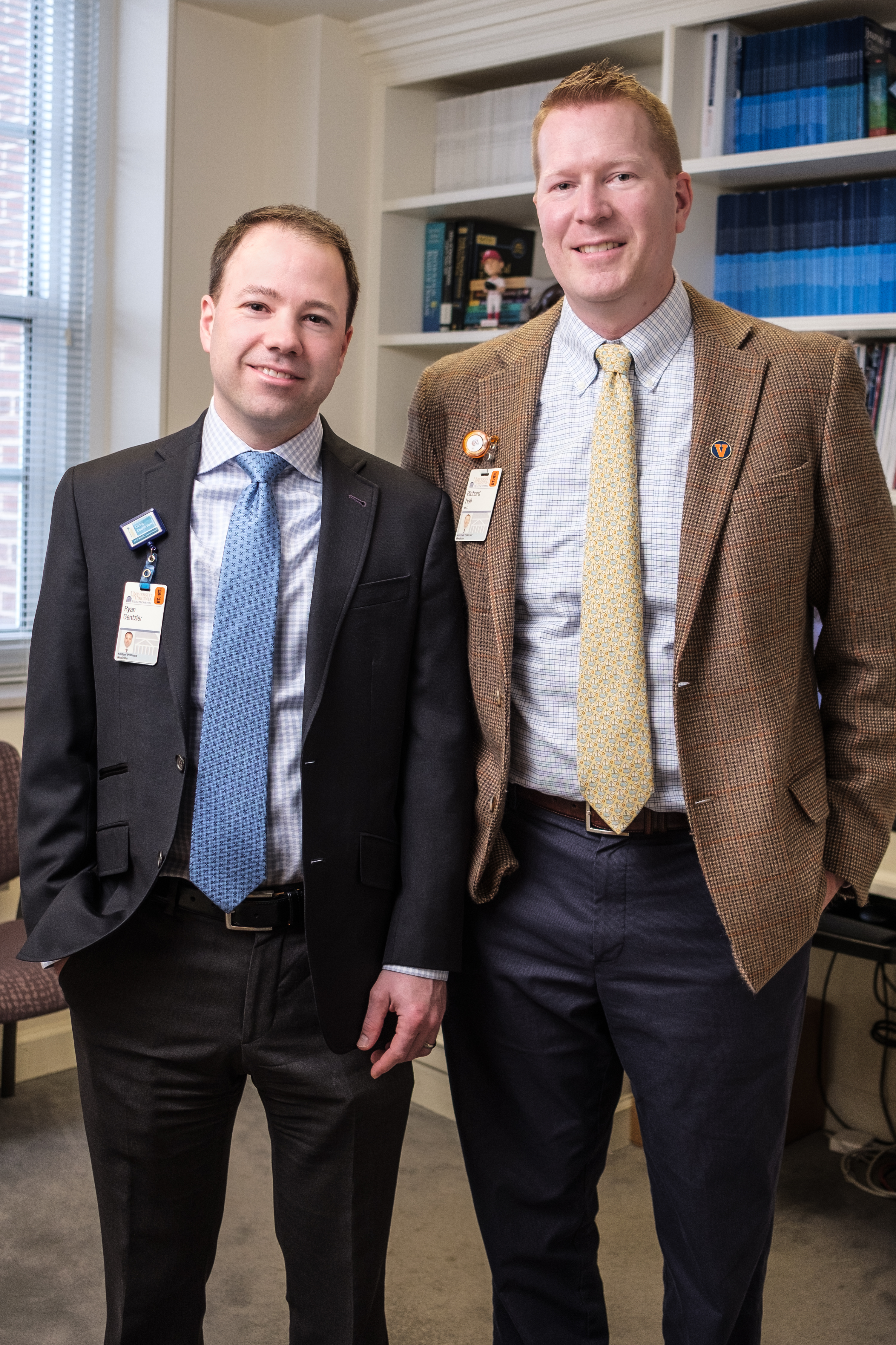 Dr. Ryan Gentzler (left) and Dr. Richard Hall stand next to each other and smile.