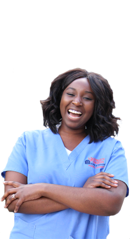 Michelle Bonsu stands in a nursing scrubs with arms crossed and laughs.