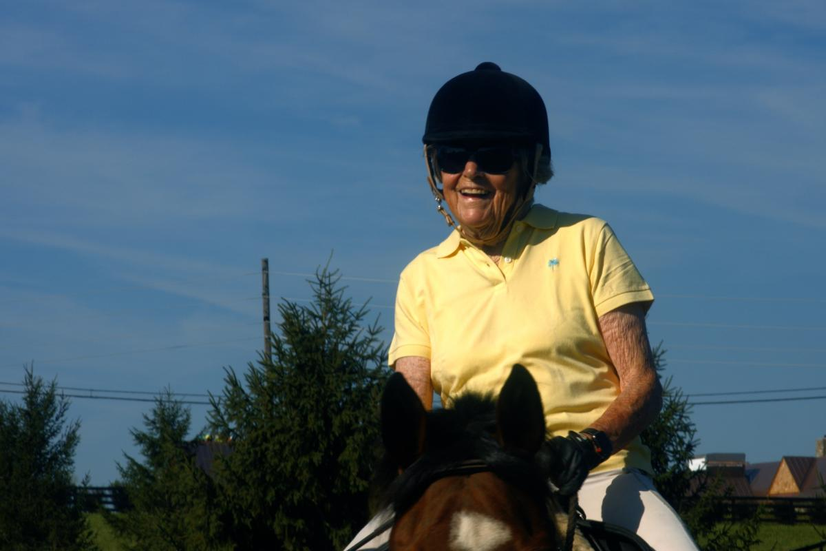 Carol Angle, age 90, a donor and grateful patient, rides her horse Tigger.