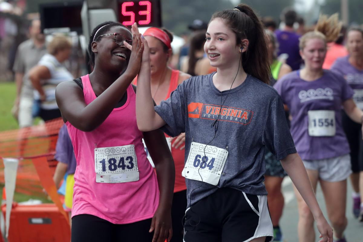 Runners high five at the Charlottesville Women's Four Miler.