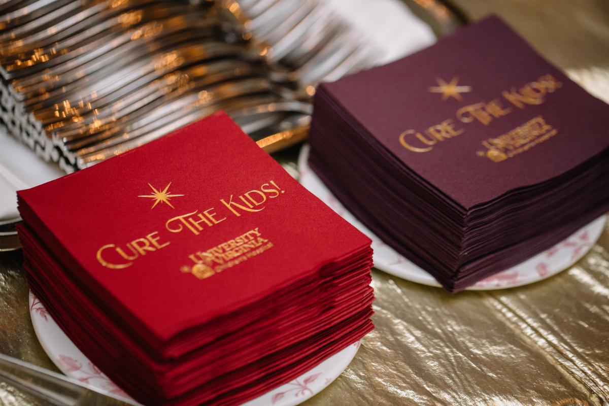 A snapshot from last year's events with napkins that say cure the kids.