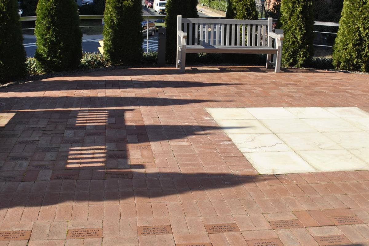 Photo of brick floors with memorial messages outside of the cancer building.