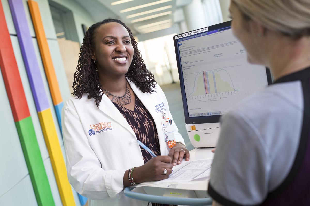 Wendy Mbugua, manager of UVA's Infusion Center, a cutting-edge technology, to improve patients' experiences.