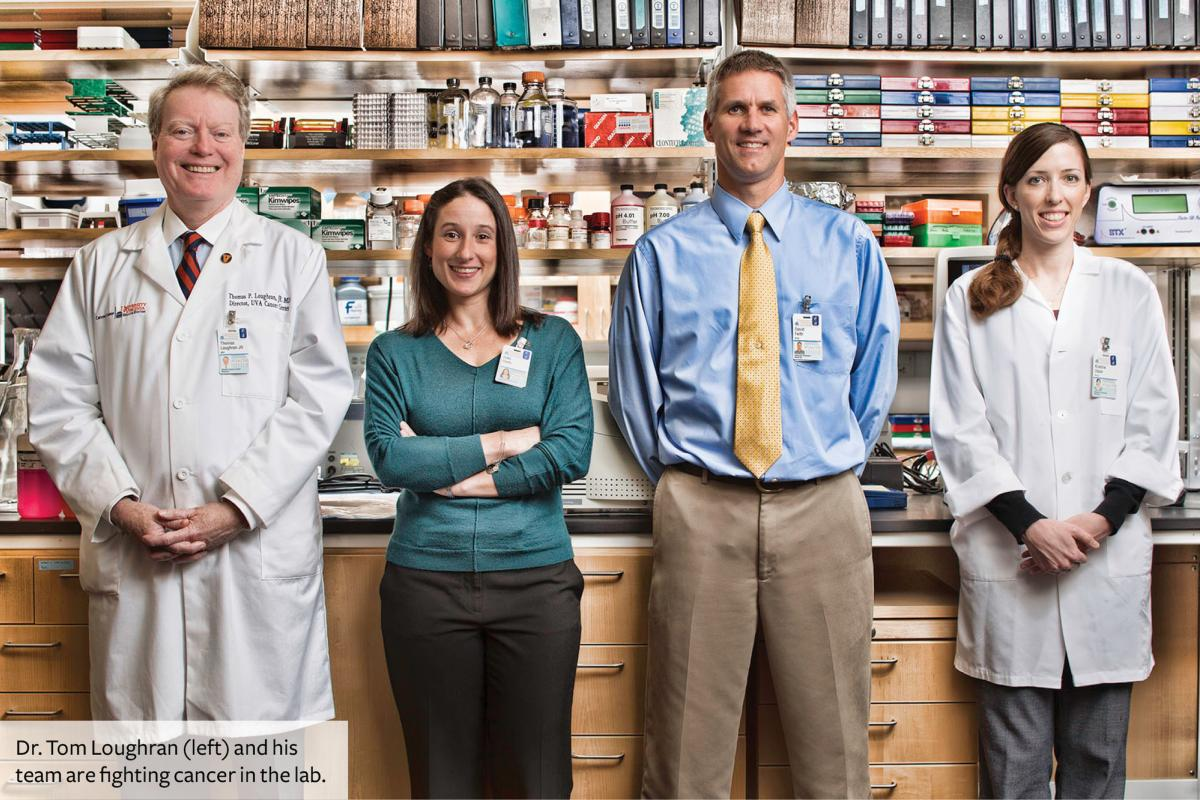 Dr. Tom Loughran and his team in the lab.