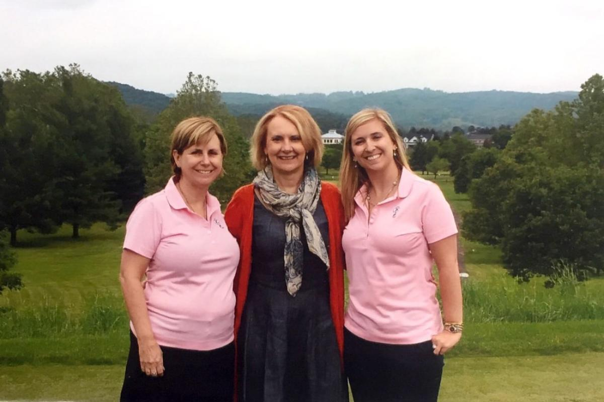 Ginny and Jennifer Marshall (left and right) share a moment with their favorite doctor, Kim Dunsmore, at a Jennifer Fund Golf tournament to support pediatric cancer research.