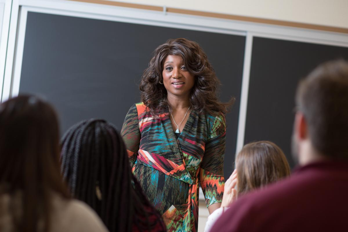 Camille Burnett, PhD, assistant professor, UVA School of Nursing, stands in front of a class