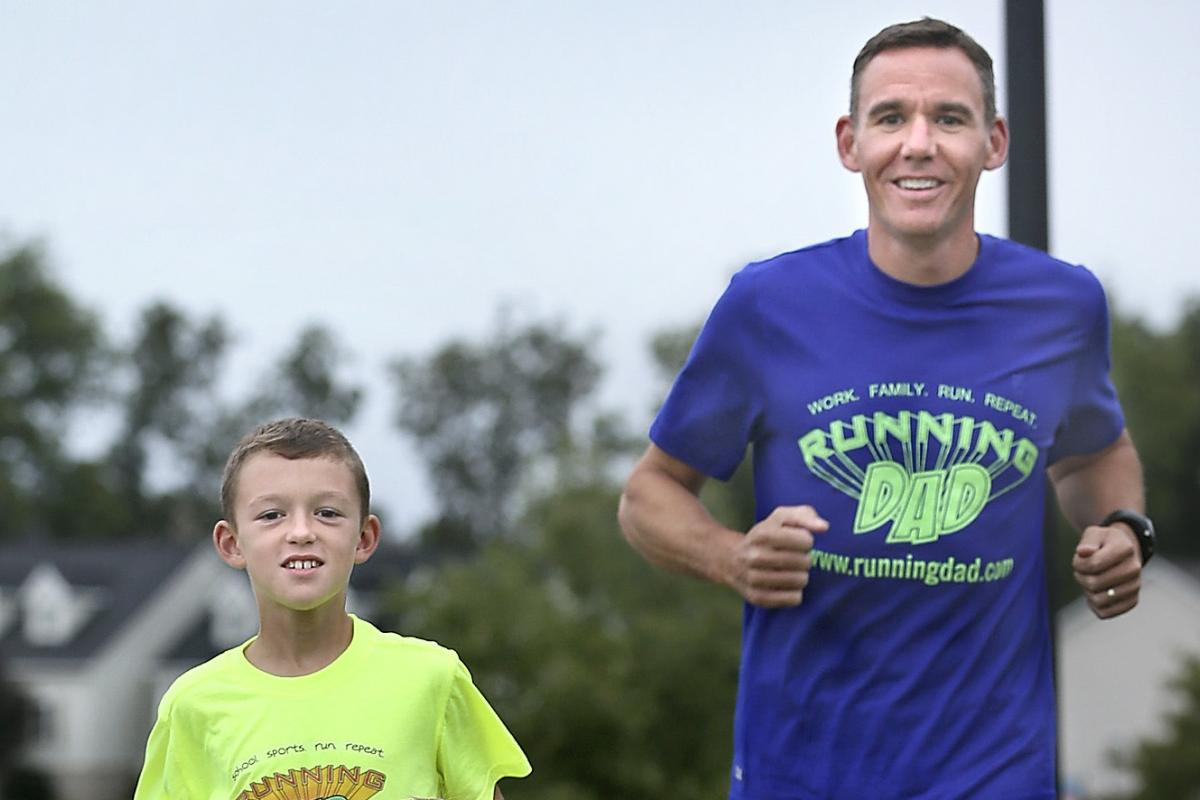 Jeremy Sanders, the running dad, runs with his son.
