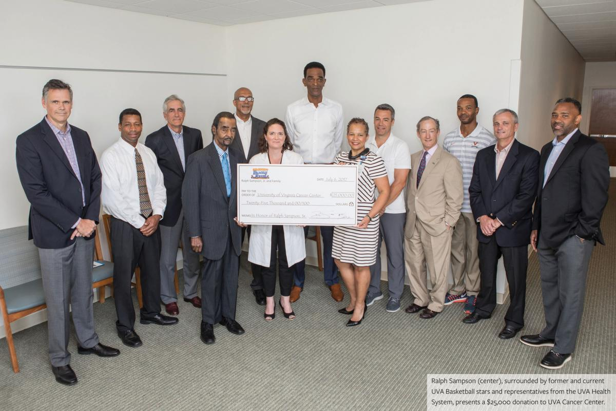 Ralph Sampson (center) surrounded by current and former UVA Basketball stars and representitives from the UVA Health System.