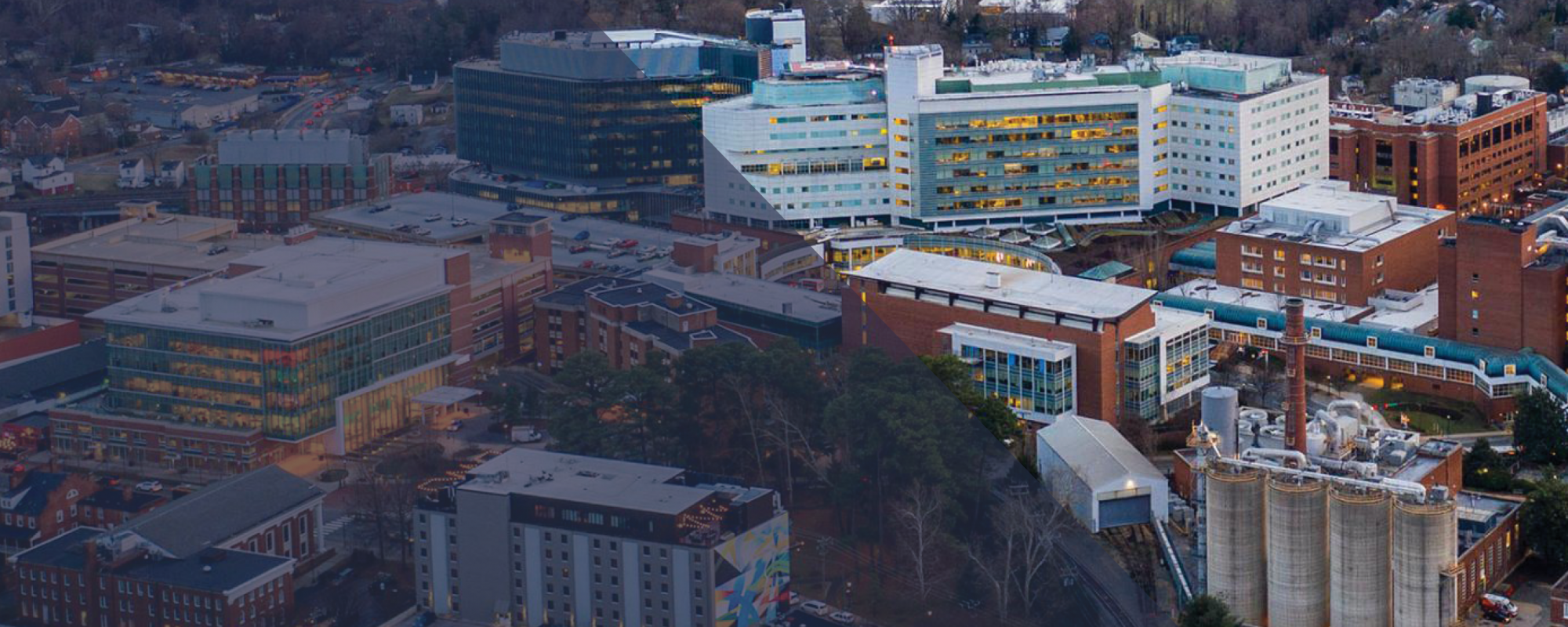 Aerial shot of UVA Health with a mountain sunset in the background.