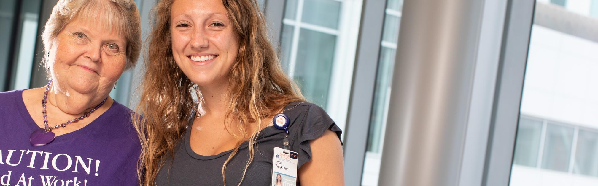 UVA patient and a UVA School of Medicine student stand together smiling.
